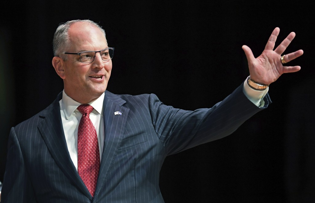 FILE - In this Sept. 19, 2019, file photo, Gov. John Bel Edwards acknowledges his supporters as he comes out onstage for a debate with Eddie Rispone a...