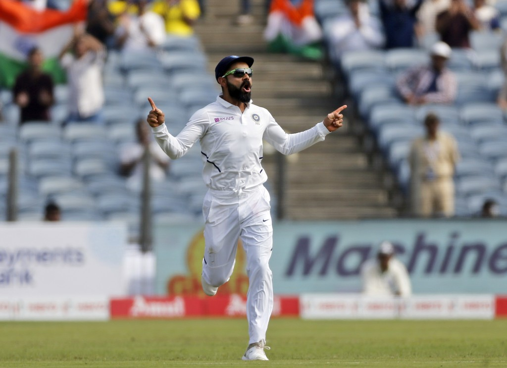 Indian cricket team captain Virat Kohli celebrates the dismissal of South Africa's Theunis de Bruyn during the third day of the second cricket test ma