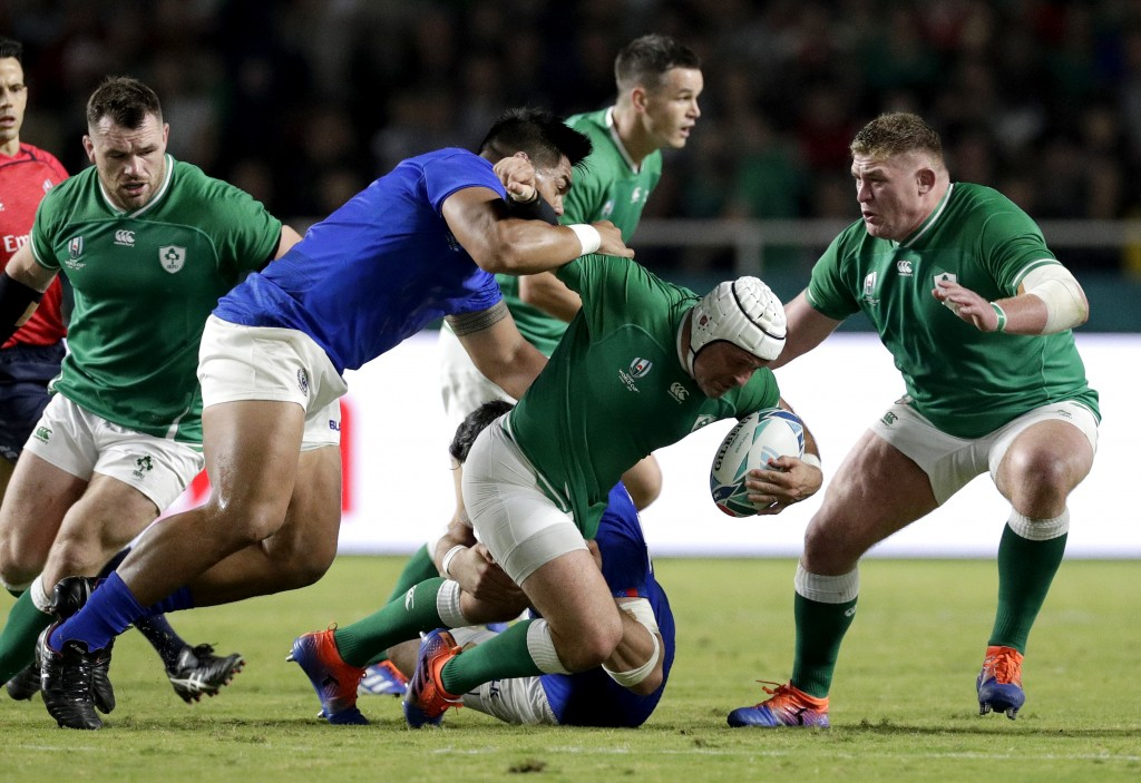 Ireland's Rory Best is tackled by the Samoan defence during the Rugby World Cup Pool A game at Fukuoka Hakatanomori Stadium between Ireland and Samoa,...