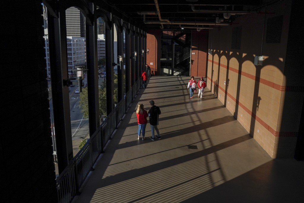 Fans arrive to Busch Stadium for Game 1 of the National League Championship Series baseball game between the St. Louis Cardinals and the Washington Na...
