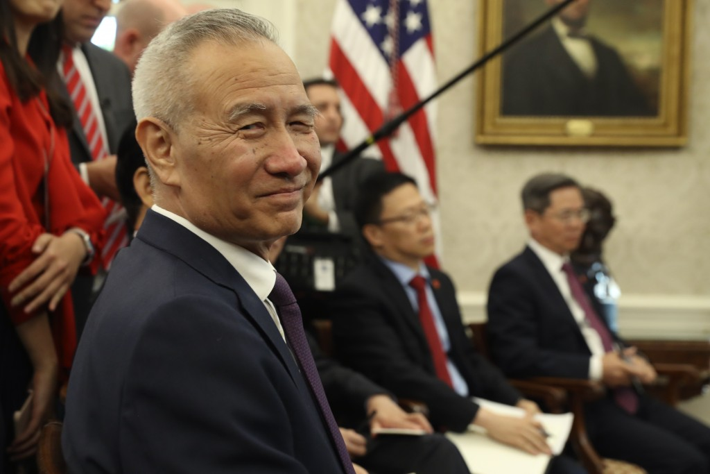 Chinese Vice Premier Liu He listens during a meeting in the Oval Office of the White House with President Donald Trump in Washington, Friday, Oct. 11,...