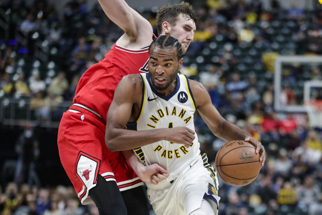 Indiana Pacers forward T.J. Warren (1) drives past Chicago Bulls forward Luke Kornet during the first half of an NBA preseason basketball game in Indi