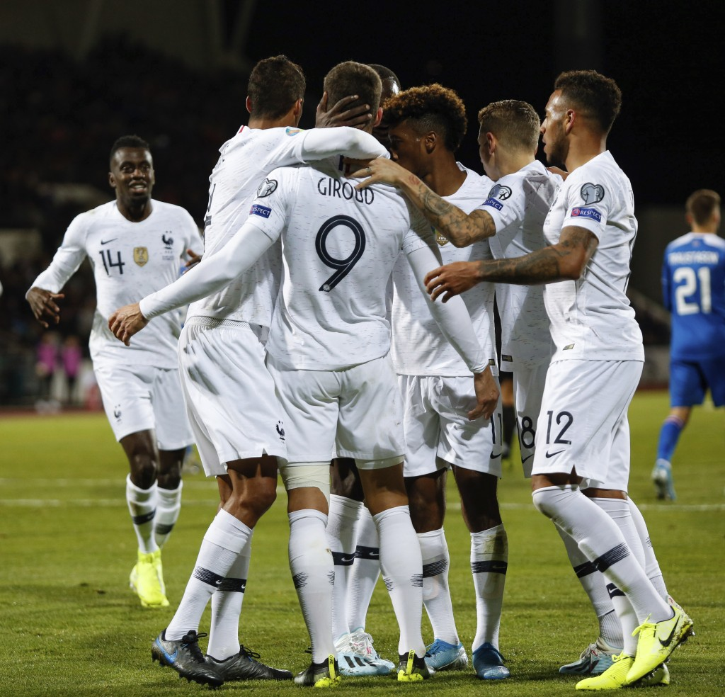 France's Olivier Giroud celebrates with teammates after scoring a goal against Iceland during a Euro 2020 group H qualifying soccer match between Ice