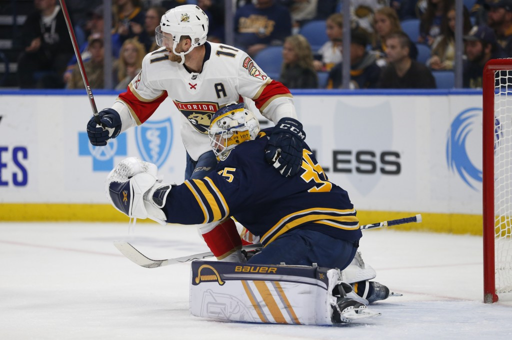 Buffalo Sabres goalie Linus Ullmark (35) and Florida Panthers forward Jonathan Huberdeau (11) collide during the second period of an NHL hockey game, ...