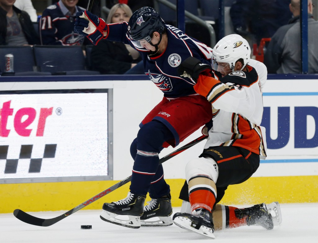 Columbus Blue Jackets forward Alexandre Texier, left, of France, works against Anaheim Ducks defenseman Cam Fowler during the second period of an NHL ...