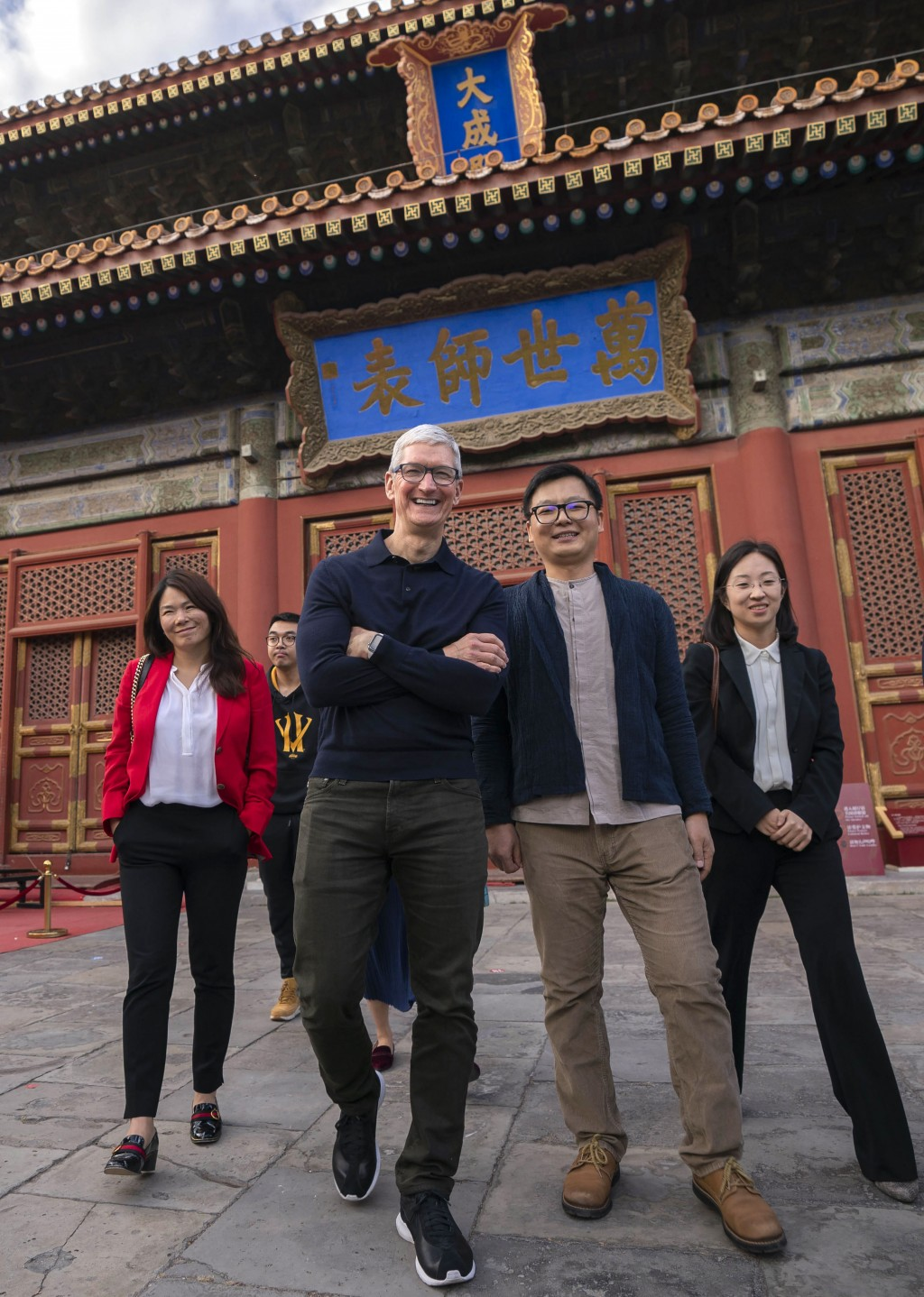 FILE - In this Oct. 10, 2018 photo released by China's Xinhua News Agency, Apple CEO Tim Cook, third from left, and Qu Zhangcai, second from right, a