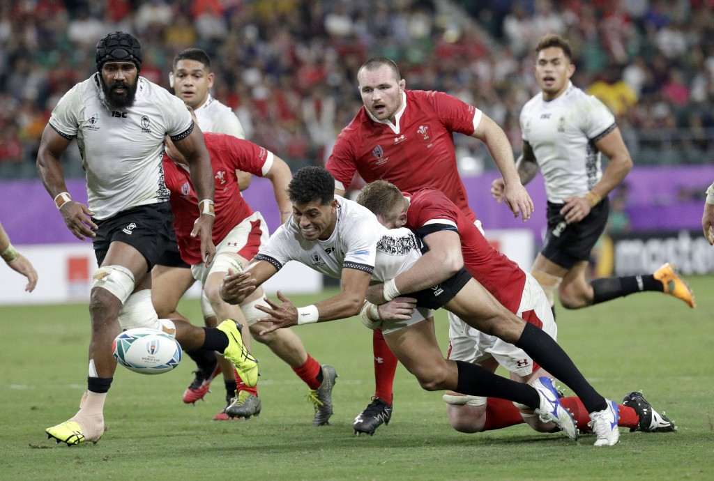 Fiji's Ben Volavola loses the ball in the tackle during the Rugby World Cup Pool D game at Oita Stadium between Wales and Fiji in Oita, Japan, Wednesd