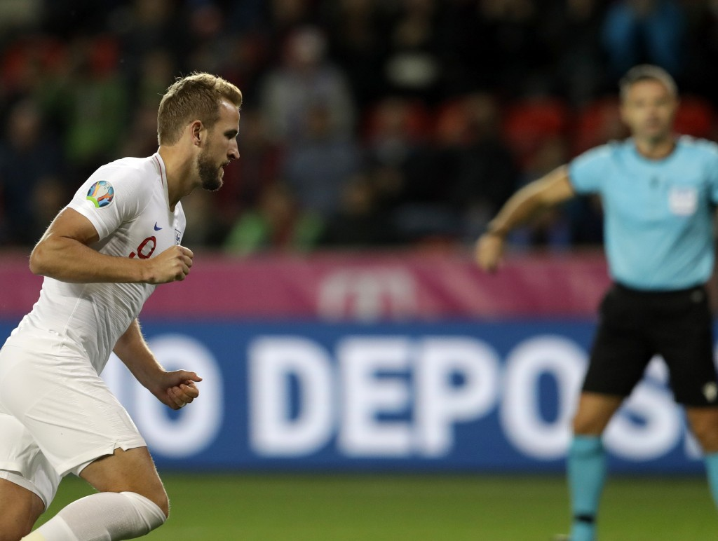 England's Harry Kane celebrates after scoring his side's opening goal from the penalty spot during the Euro 2020 group A qualifying soccer match betwe...