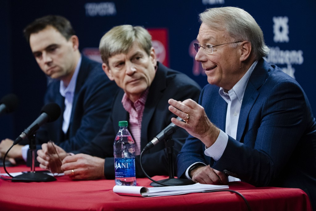 Philadelphia Phillies president Andy MacPhail, right, speaks during a news conference as general manager Matt Klentak, left, and managing partner John...