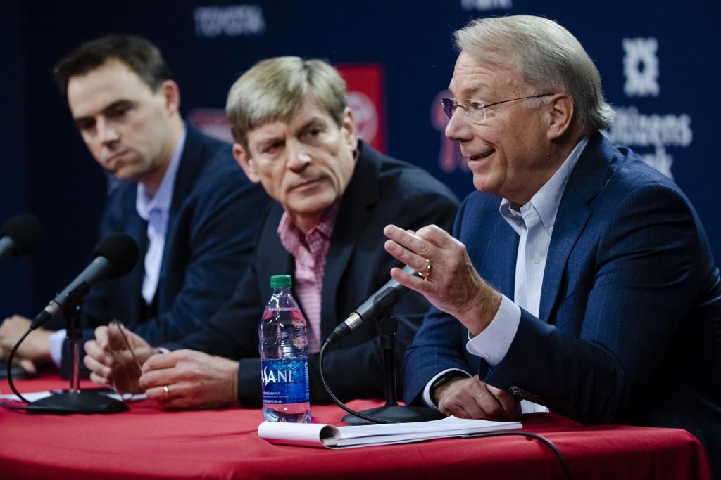 Philadelphia Phillies president Andy MacPhail, right, speaks during a news conference as general manager Matt Klentak, left, and managing partner John