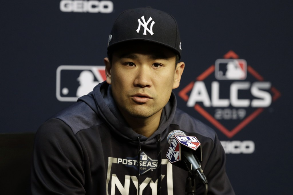 New York Yankees starting pitcher Masahiro Tanaka talks with the media during a news conference for a baseball American League Championship Series in ...