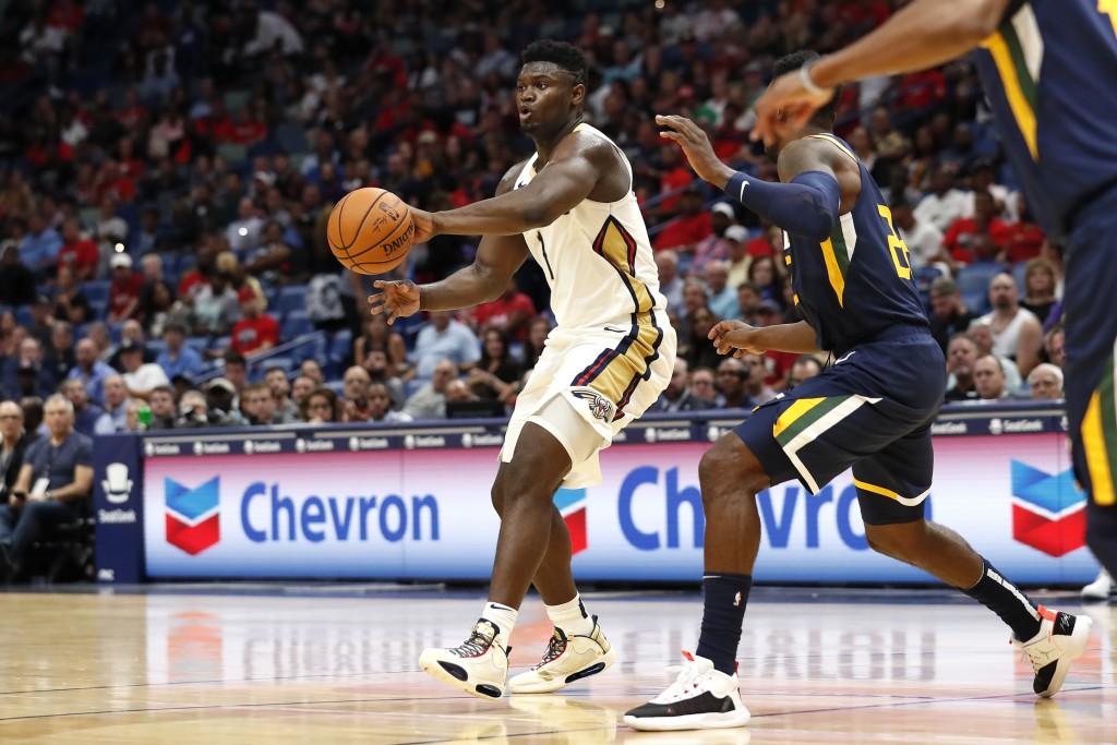 New Orleans Pelicans forward Zion Williamson (1) drives past Utah Jazz forward Jeff Green (22) during the first half of a preseason NBA basketball gam...