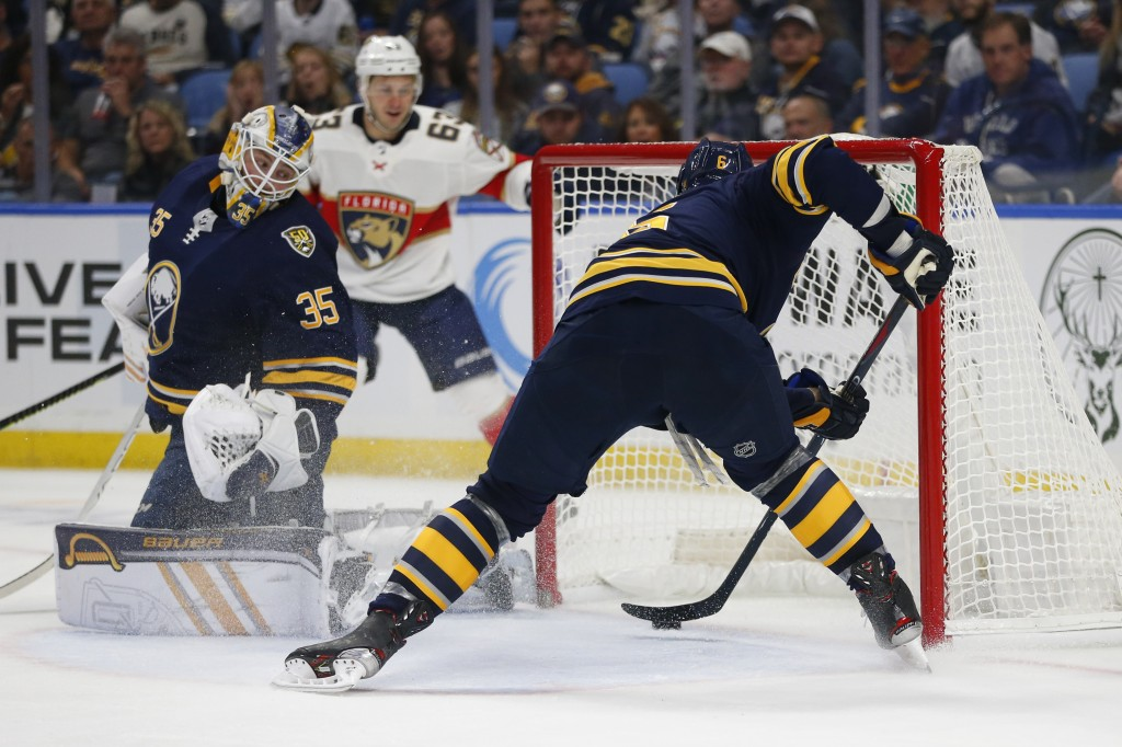 Buffalo Sabres defenseman Marco Scandella (6) stops the puck from crossing the goal line during the second period of an NHL hockey game against the Fl...