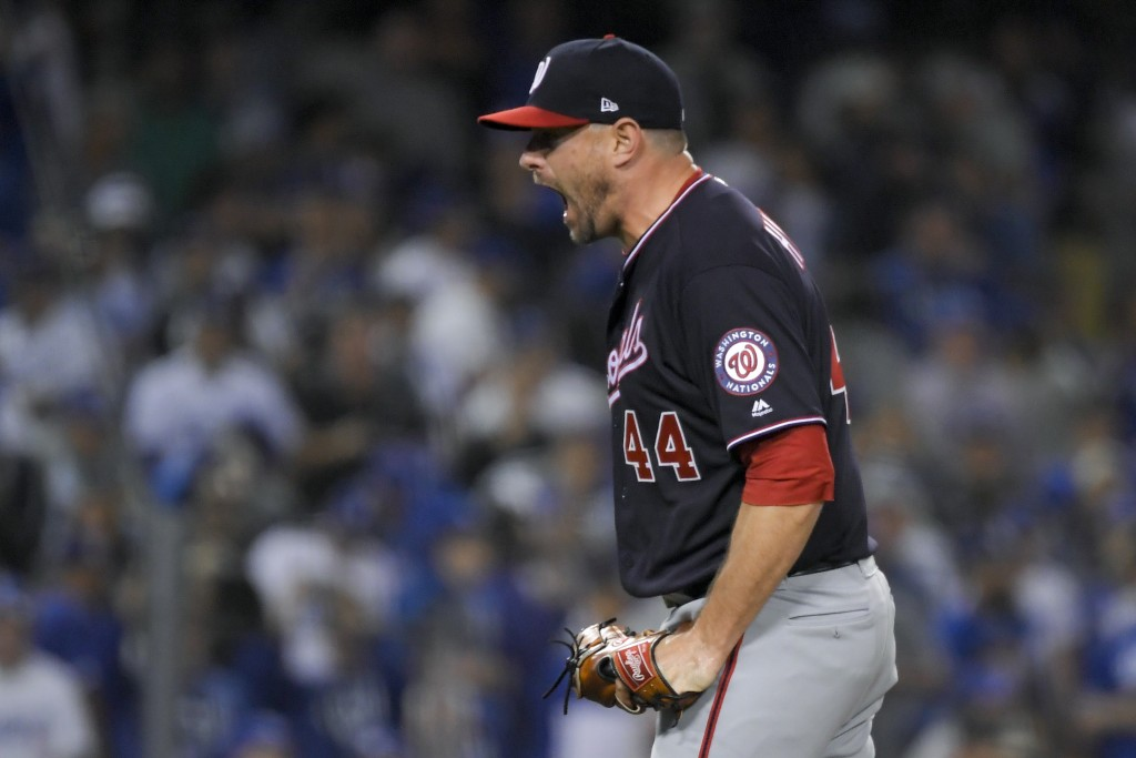 Washington Nationals relief pitcher Daniel Hudson celebrates after the final out in Game 2 of the baseball team's National League Division Series agai...
