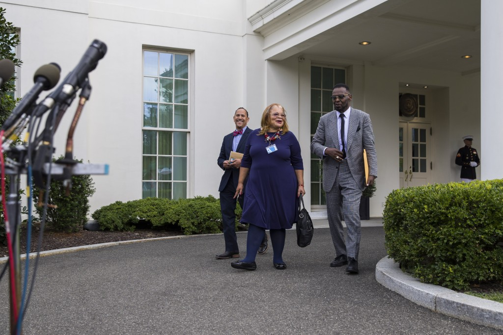 FILE - In this July 29, 2019 file photo, Alveda King, a niece of Martin Luther King, Jr., center, arrives to speak with reporters, accompanied by Rev....