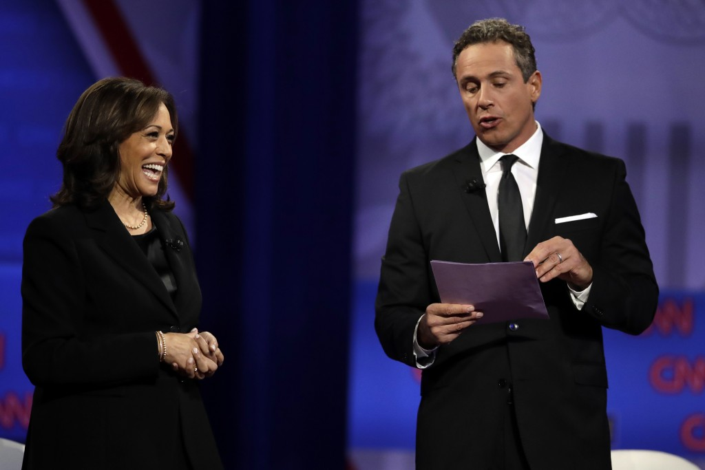Democratic presidential candidate Sen. Kamala Harris, D-Calif., laughs as CNN moderator Chris Cuomo speaks during the Power of our Pride Town Hall Thu...