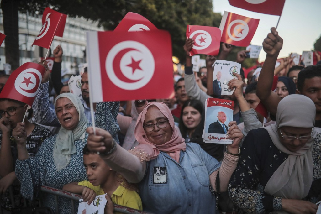 Supporters of independent Tunisian Presidential candidate Kais Saied attend a rally on the last day of campaigning before the second round of the pres...