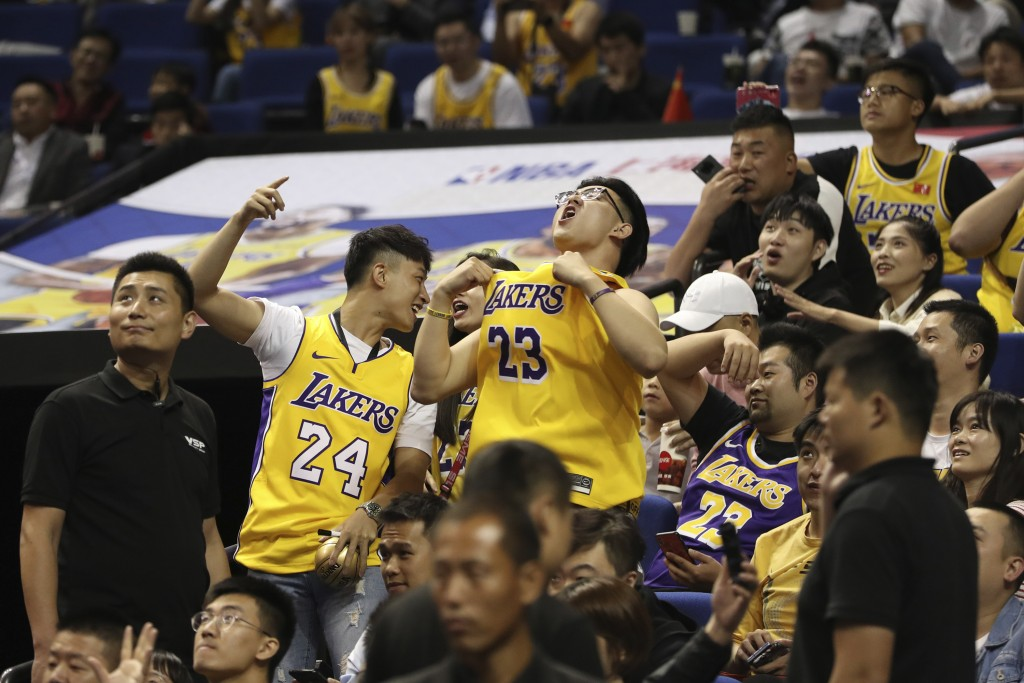 FILE - In this Thursday, Oct. 10, 2019 file photo, Chinese fans react during a preseason NBA basketball game between the Brooklyn Nets and Los Angeles