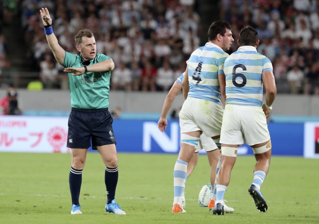 Referee Nigel Owens gestures as he awards a penalty against Argentina during the Rugby World Cup Pool C game at Tokyo Stadium between England and Arge...