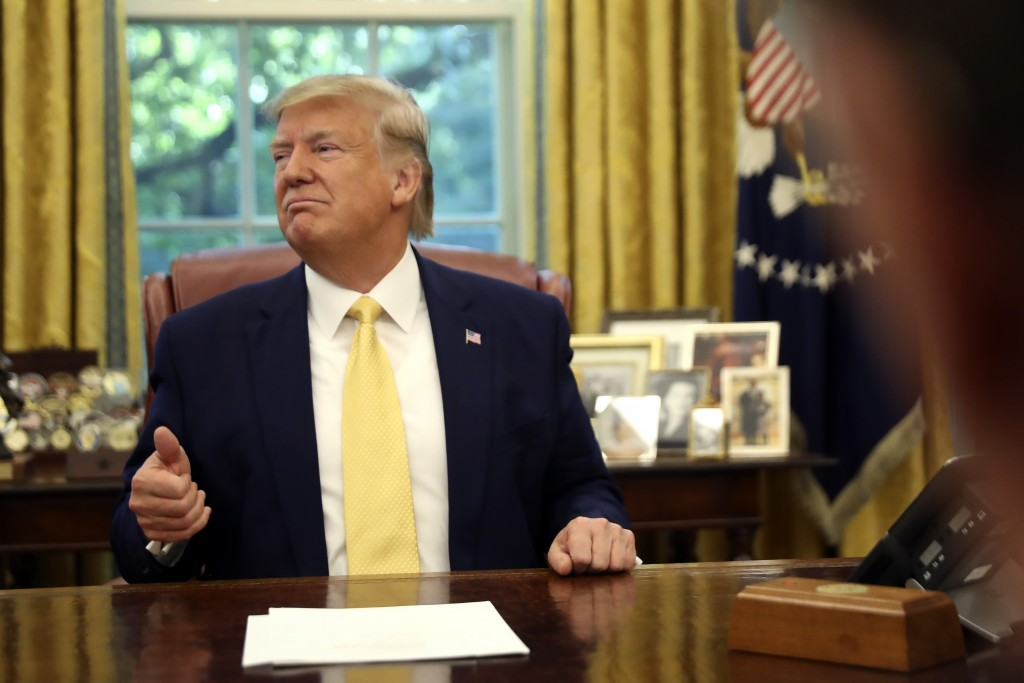 President Donald Trump listens he meets with Chinese Vice Premier Liu He in the Oval Office of the White House in Washington, Friday, Oct. 11, 2019. (