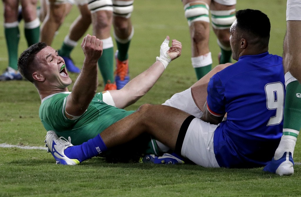 Ireland's Johnny Sexton celebrates after scoring a try during the Rugby World Cup Pool A game at Fukuoka Hakatanomori Stadium between Ireland and Samo...