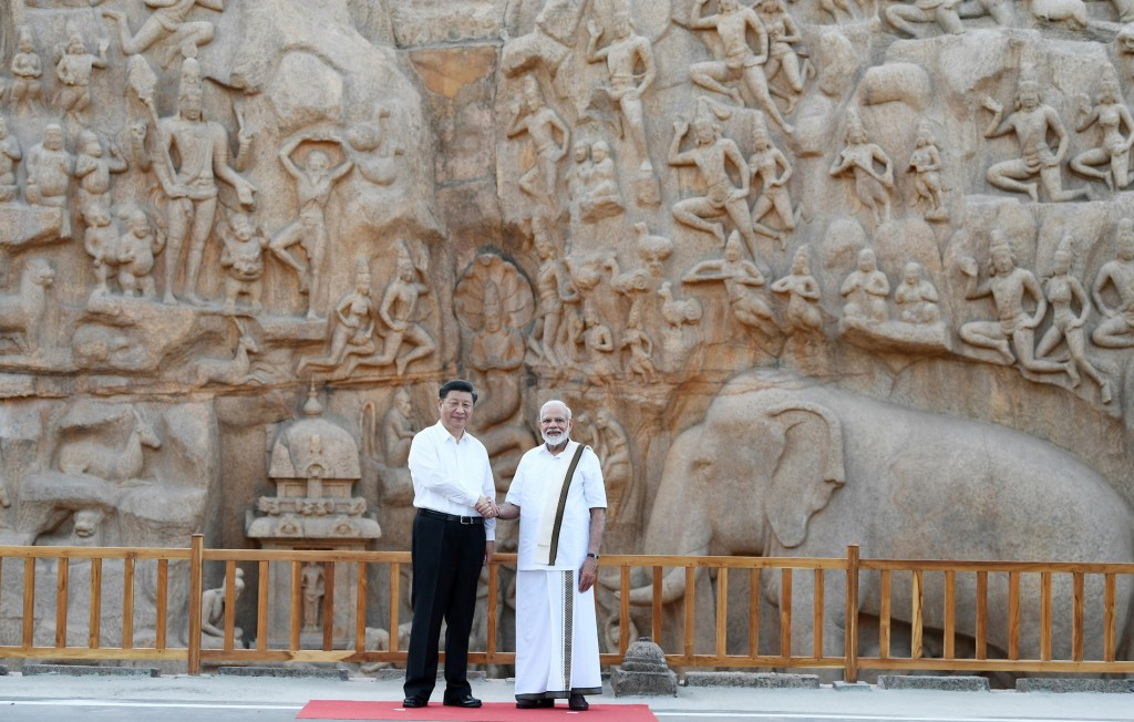 In this Friday, Oct. 11, 2019, handout photo provided by the Indian Prime Minister's Office, Chinese President Xi Jinping and Indian Prime Minister Na...