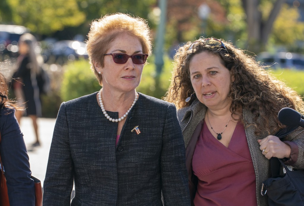 Former U.S. ambassador to Ukraine Marie Yovanovitch, left, arrives on Capitol Hill, Friday, Oct. 11, 2019, in Washington, as she is scheduled to testi