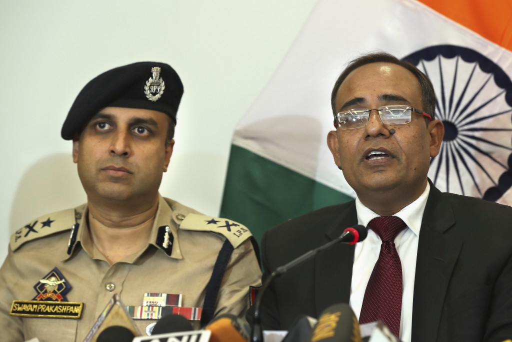 Government spokesperson Rohit Kansal, right, speaks as Swayam Prakash Pani, left, Inspector General of Police of Kashmir Range during a press conferen...