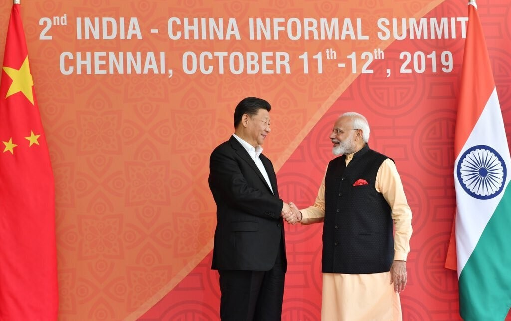 In this handout photo provided by the Indian Prime Minister's Office, Chinese President Xi Jinping and Indian Prime Minister Narendra Modi shake hands...