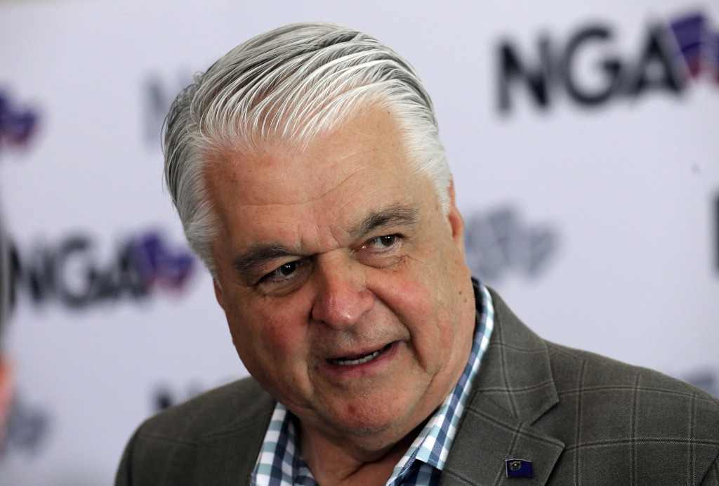 FILE - This July 24, 2019 file photo shows Nevada Gov. Steve Sisolak speaks during a news conference at the summer meeting of the National Governors A