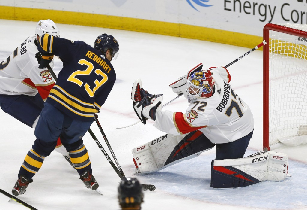 Buffalo Sabres forward Sam Reinhart (23) is stopped by Florida Panthers goalie Sergei Bobrovsky (72) during the first period of an NHL hockey game, Fr...