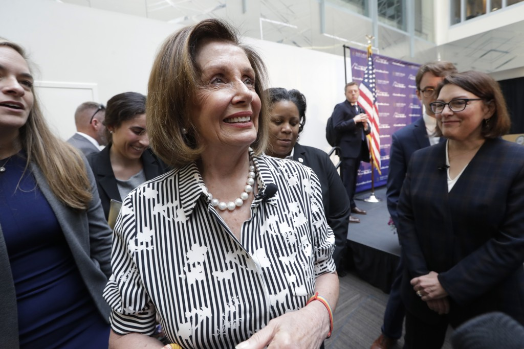 Speaker of the House Nancy Pelosi, D-Calif., left, turns to speak with media members with Rep. Suzan DelBene, D-Wash., right, after they spoke about l...