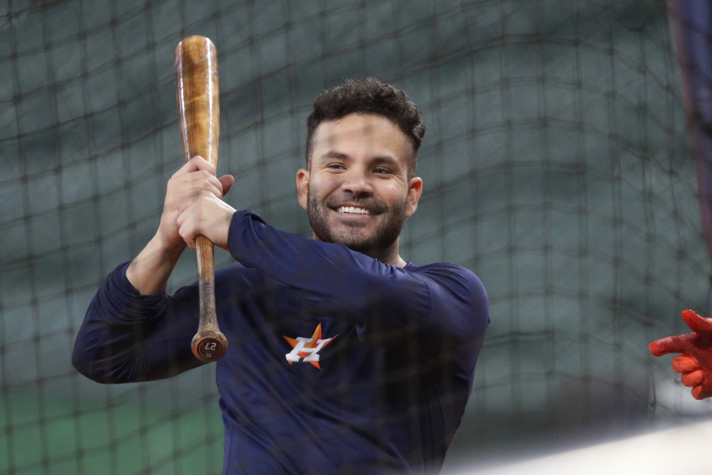 Houston Astros' Jose Altuve takes batting practice during a workout for a baseball American League Championship Series in Houston, Friday, Oct. 11, 20...