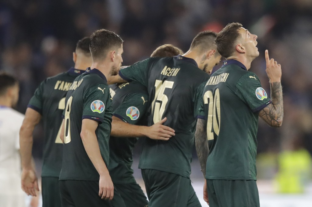Italy's Frederico Bernardeschi, right celebrates with teammates after scoring his side second gaol during the Euro 2020 group J qualifying soccer matc...
