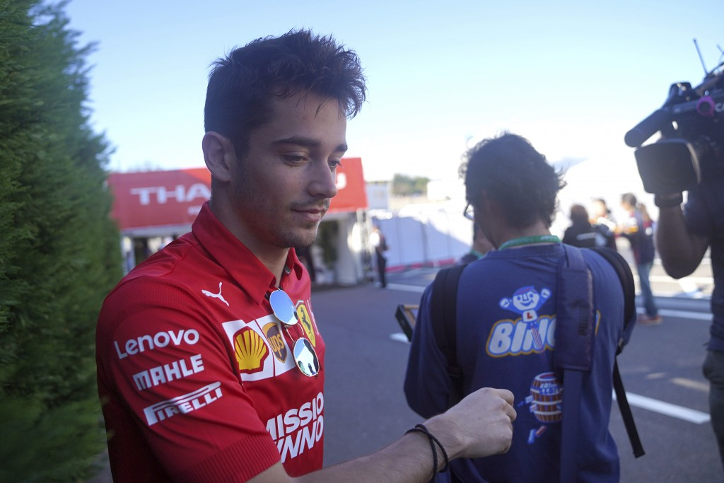 Ferrari driver Charles Leclerc of Monaco arrives at the paddock ahead of the Japanese Formula One Grand Prix at Suzuka Circuit in Suzuka, central Japa...