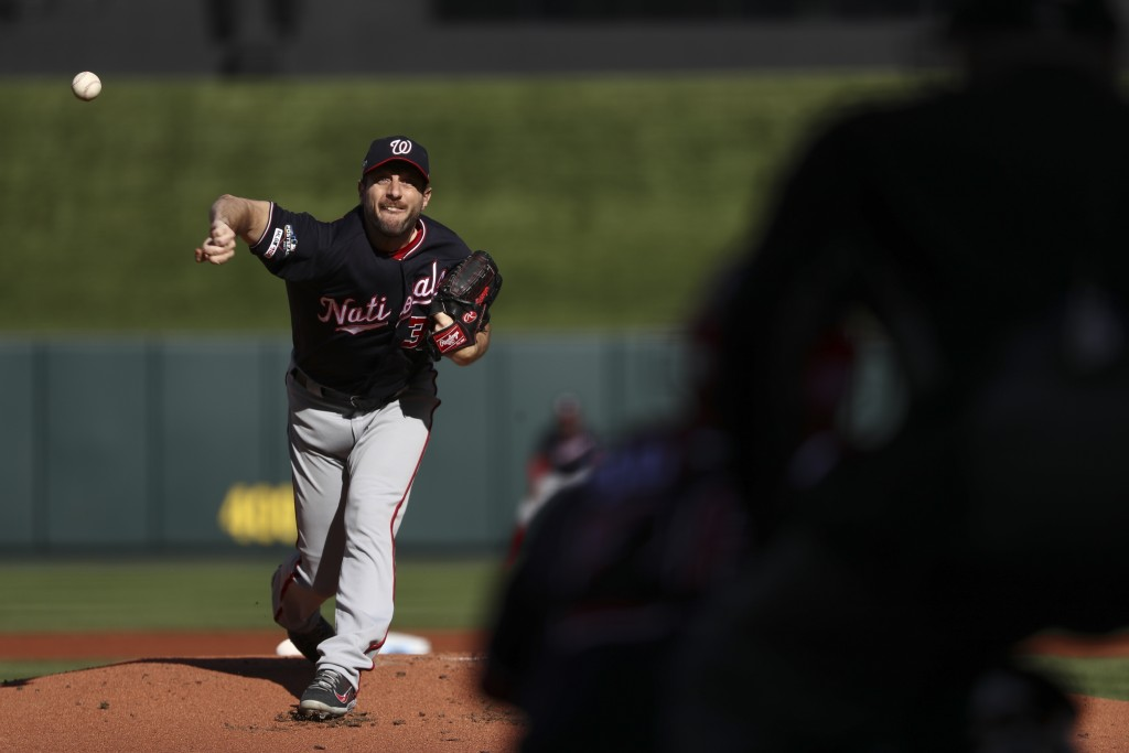Washington Nationals starting pitcher Max Scherzer throws during the first inning of Game 2 of the baseball National League Championship Series agains...