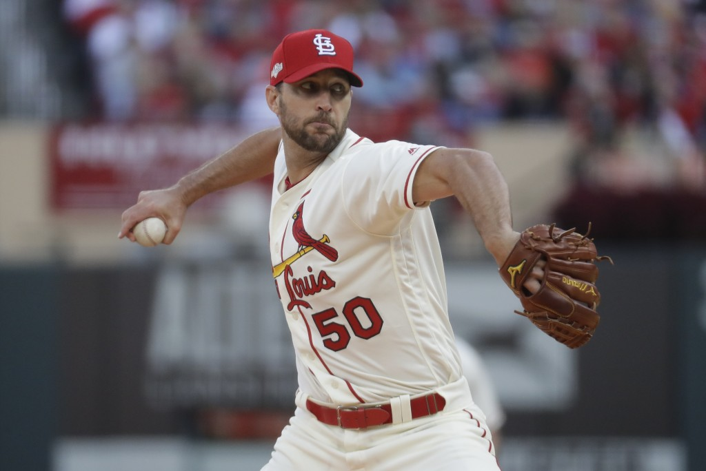 St. Louis Cardinals starting pitcher Adam Wainwright throws during the fourth inning of Game 2 of the baseball National League Championship Series aga