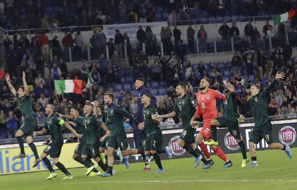 The Italian soccer team celebrates after the end of the Euro 2020 group J qualifying soccer match between Italy and Greece in Rome, Italy, Saturday, O