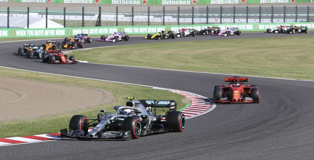Mercedes driver Valtteri Bottas of Finland leads Ferrari driver Sebastian Vettel of Germany at the start of the Japanese Formula One Grand Prix at Suz...