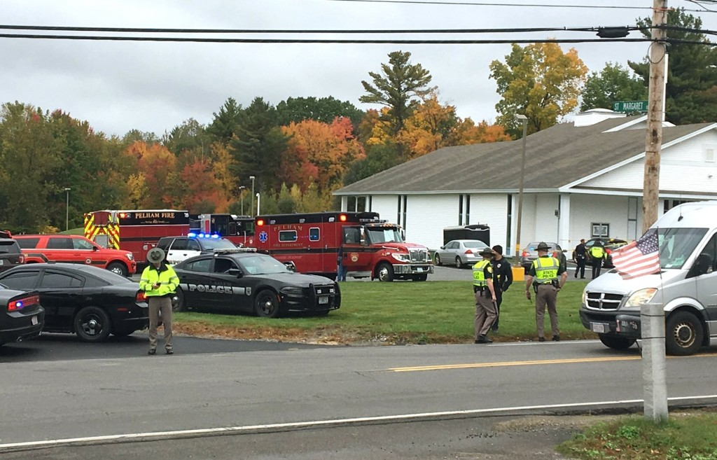 RETRANSMITTED WITH NEW SLUG AND BETTER QUALITY  - In this photo provided by WMUR-TV, police stand outside the New England Pentecostal Church after rep...