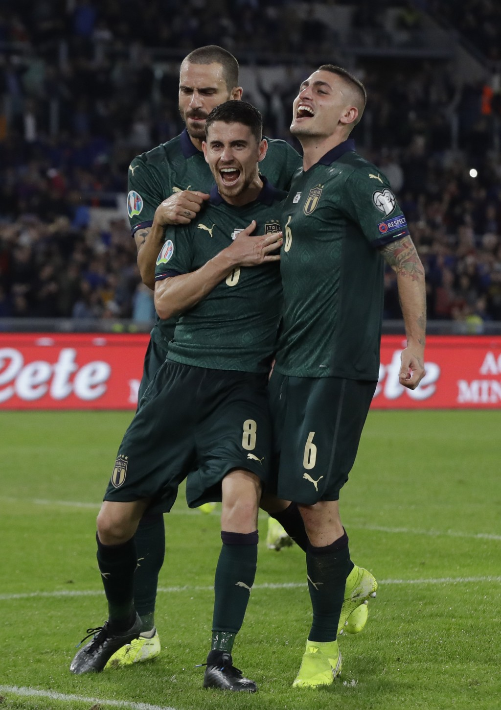 Italy's Jorginho, (8), celebrates with teammates after he scores the opening goal of the game from the penalty spot during the Euro 2020 group J quali...
