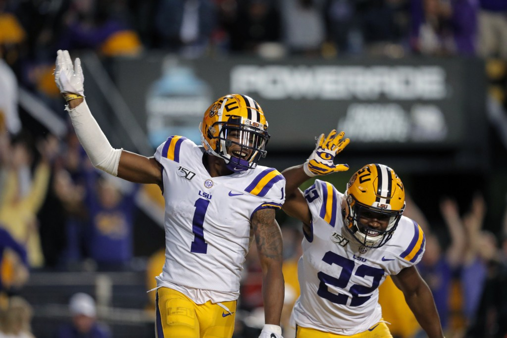 LSU wide receiver Ja'Marr Chase (1) celebrates his touchdown reception with running back Clyde Edwards-Helaire (22) in the second half of an NCAA coll...