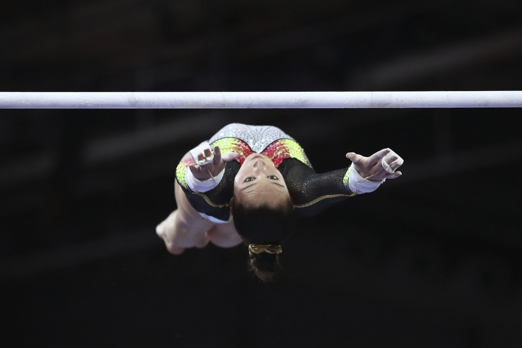 Nina Derwael of Belgium performs on the uneven bars to win a gold medal in the women's apparatus finals at the Gymnastics World Championships in Stutt...