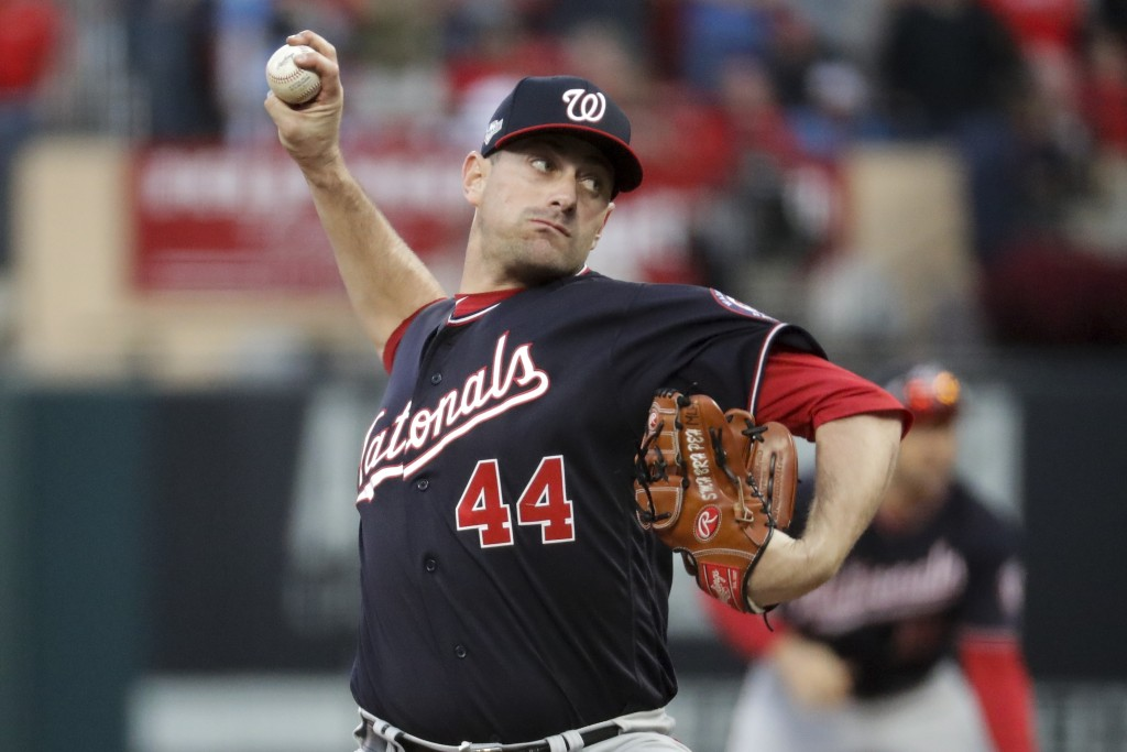 Washington Nationals relief pitcher Daniel Hudson throws during the ninth inning of Game 2 of the baseball National League Championship Series against...