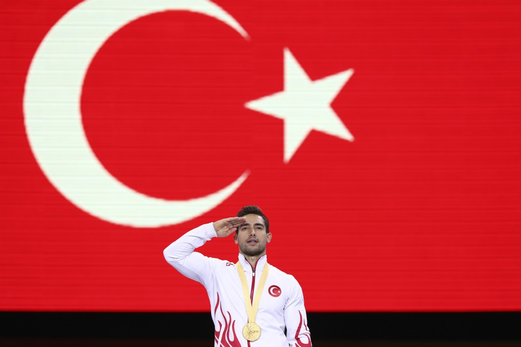 Gold medalist on the rings Ibrahim Colak of Turkey celebrates on the podium after the men's apparatus finals at the Gymnastics World Championships in ...
