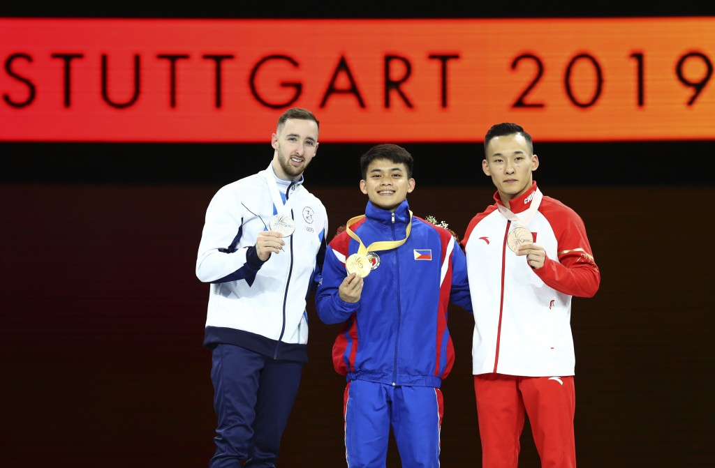 Carlos Edriel Yulo of the Philippines, center and gold medal, Artem Dolgopyat of Israel, left and silver medal, and Xiao Ruoteng of China, right and b...