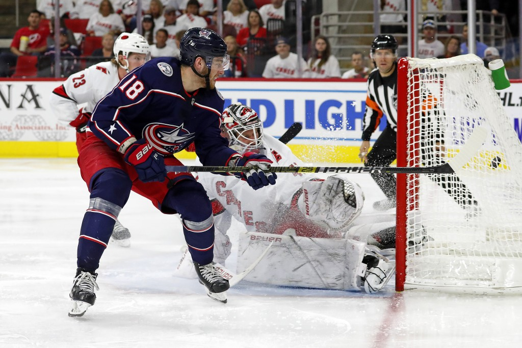 Columbus Blue Jackets' Pierre-Luc Dubois (18) gets his shot past Carolina Hurricanes goaltender James Reimer (47) for a goal during the third period o...