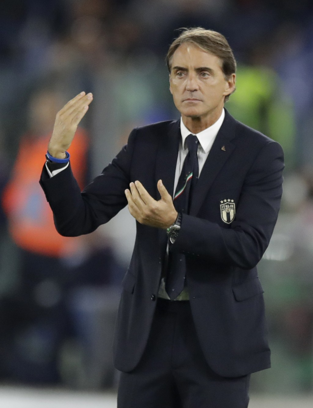 Italy coach Roberto Mancini gestures to his players during the Euro 2020 group J qualifying soccer match between Italy and Greece in Rome, Italy, Satu...