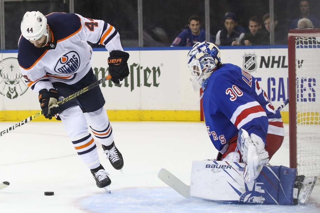 New York Rangers goaltender Henrik Lundqvist (30) defends against Edmonton Oilers right wing Zack Kassian (44) during the first period of an NHL hocke...