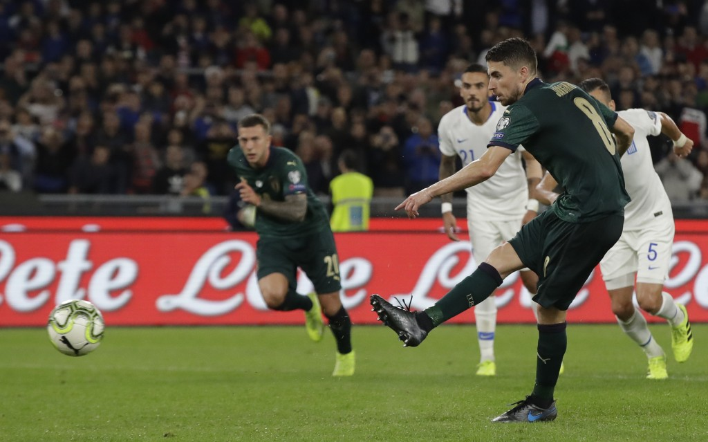 Italy's Jorginho shoots and scores the opening goal of the game from the penalty spot during the Euro 2020 group J qualifying soccer match between Ita...